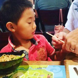 Learning to use chopsticks noodles familylife chopsticks