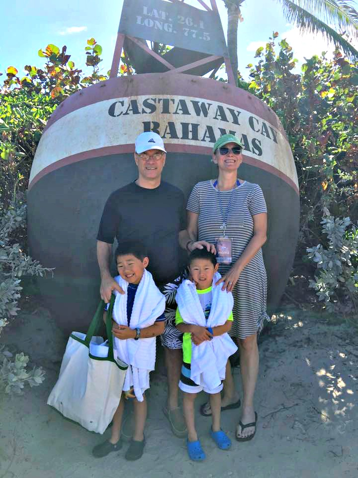 Family of four with Asian children at Castaway Cay|10 Tips to help you get the most out of Castaway Cay