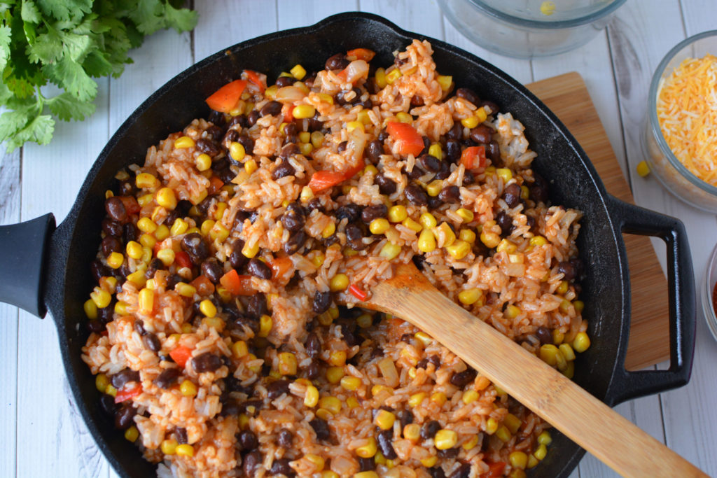 This easy enchilada skillet dinner is one of my family's go-to weeknight dinners. This easy, weeknight, one skillet meatless meal can be made with ingreidents you probably have on hand|Ripped Jeans and Bifocals
