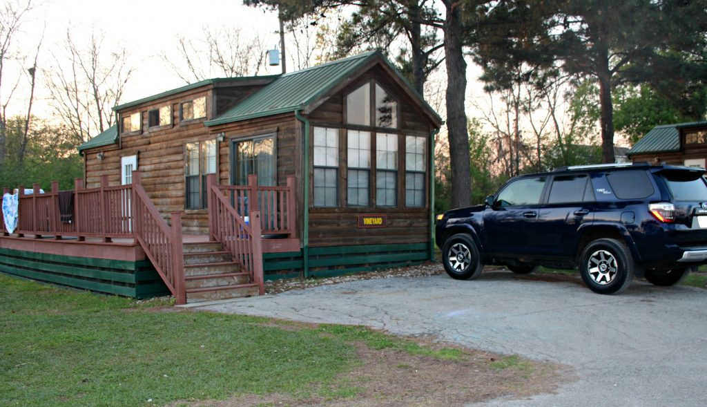 Log cabin with SUV