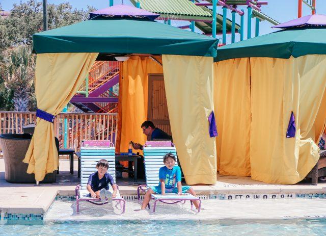 Two boys outside premium cabana at Aquatica San Antonio