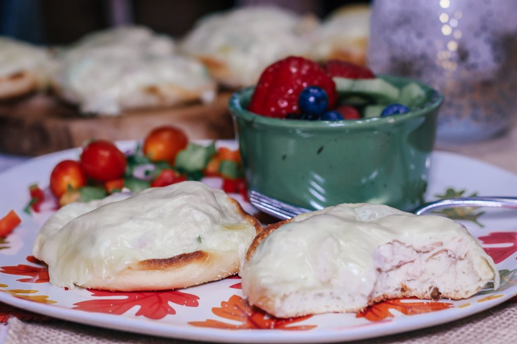 English Muffin Tuna Melt on patterned plate with fruit salad How to make an easy tuna melt using English Muffins