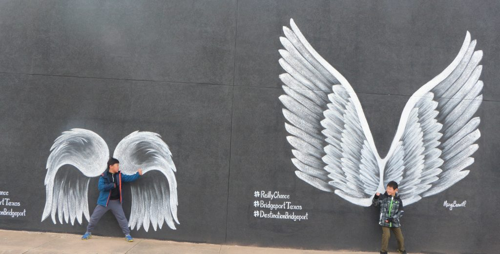 Best places to take Instagram Photos in Decatur Texas|Bridgeport Texas two boys at the angel wing mural