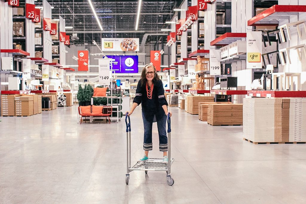 Should bloggers and influencers charge a day rate or an event fee?|Woman on a cart at Ikea Store