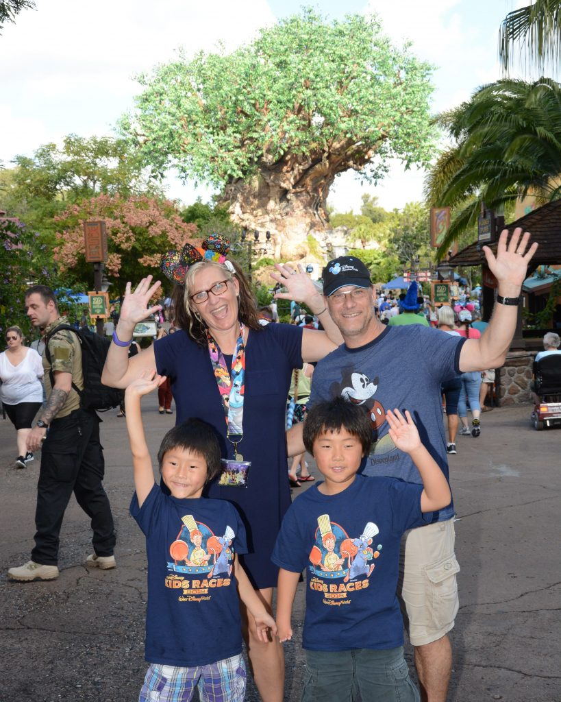 Disney Wine and Dine Half Marathon Weekend - Your Questions Answered|Run Disney Ripped Jeans and Bifocals Family in front of tree of life at Disney's Animal Kingdom