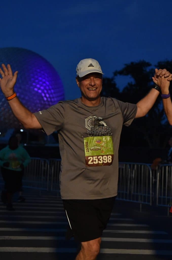 Disney Wine and Dine Half Marathon Weekend - Your Questions Answered|Run Disney Ripped Jeans and Bifocals Man in gray shirt and black shorts running at Epcot