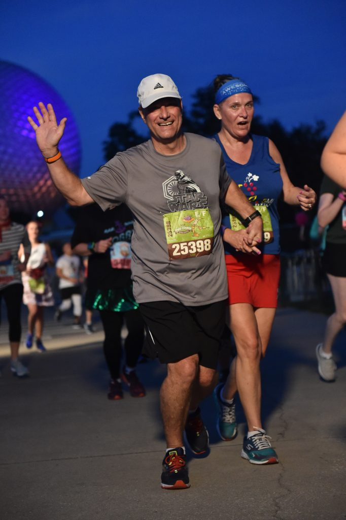 Disney Wine and Dine Half Marathon Weekend - Your Questions Answered|Run Disney Ripped Jeans and Bifocals man and woman running together at Epcot