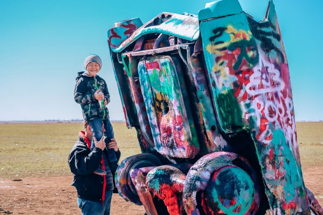 How to unplug on vacation|Boy and dad spray painting cars at Cadillac ranch