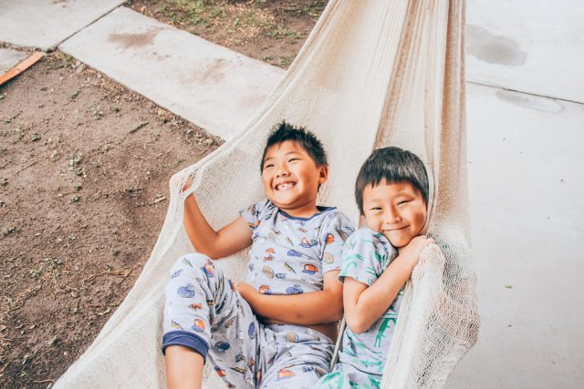 How to have an unplugged family vacation|Two Asian boys in a hammock