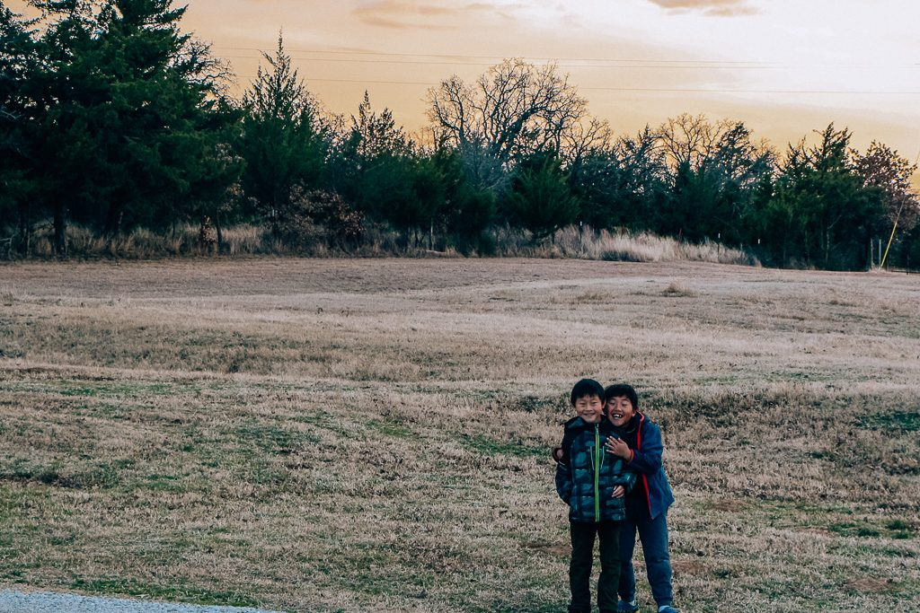 Best places to take Instagram Photos in Decatur Texas|Two boys in a field at Marker Cellars