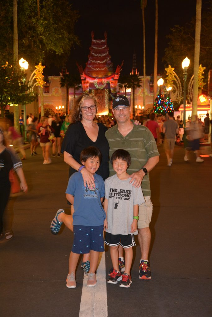 Open to close touring plan for Disney's Hollywood Studios|family of four at Disney's Hollywood studios at night