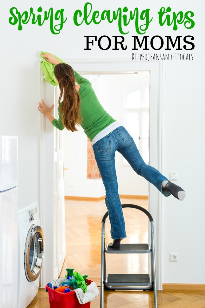 Unexpected places moms have to spring clean|Woman on a ladder cleaning wearing a green sweater.