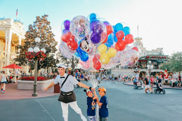 Disney World Planning can teach you where the best photo spots are|Little boys with balloons at the Magic Kingdom
