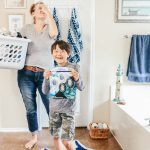 Mom with laundry basket Febreze small spaces
