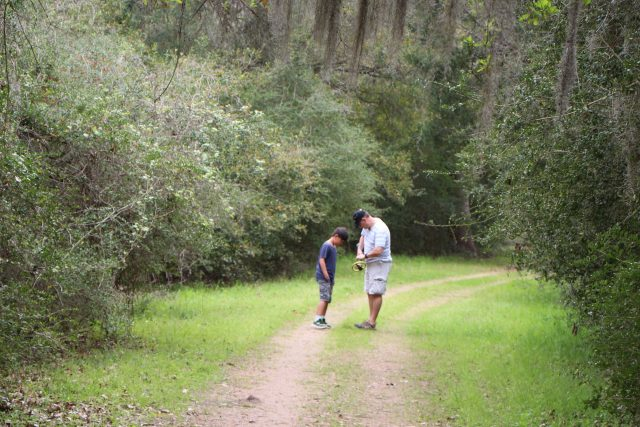 Man and boy with metal detector