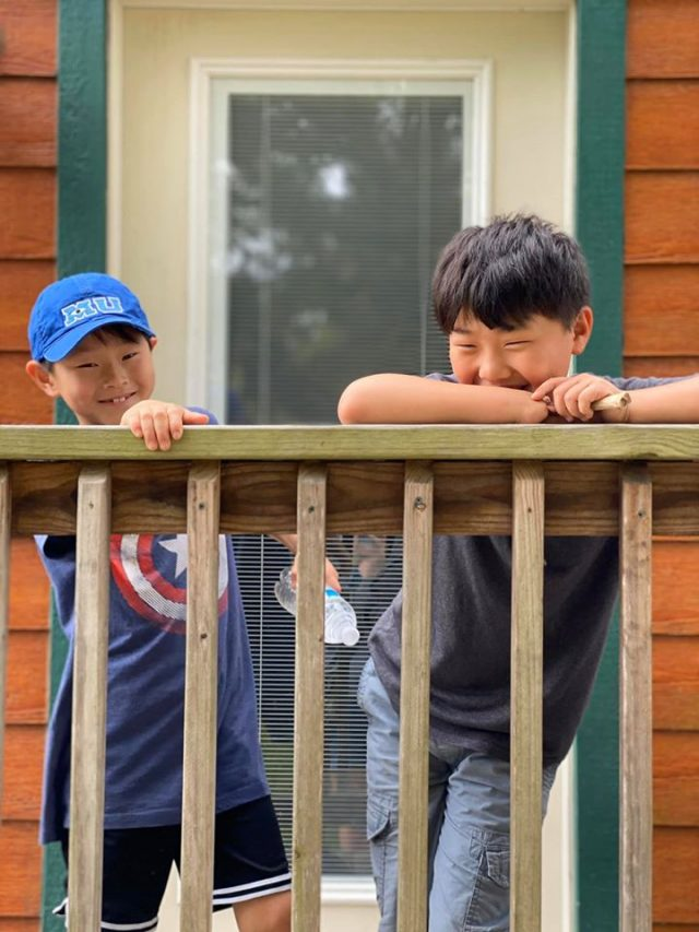Two boys on the porch at Thousand Trails RV Park in Columbus TX
