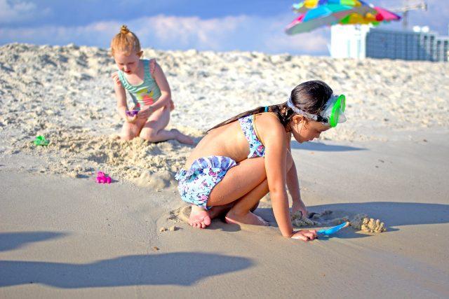 Kids playing on Alabama Beaches