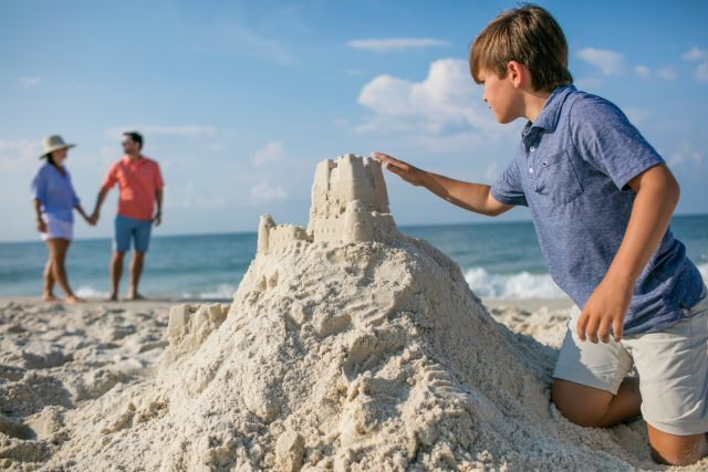boy making sandcastle Gulf Shores
