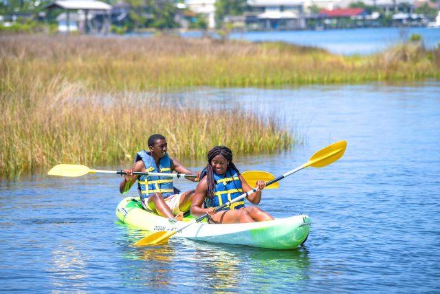 Couple kayaking in Gulf Shores Alabama