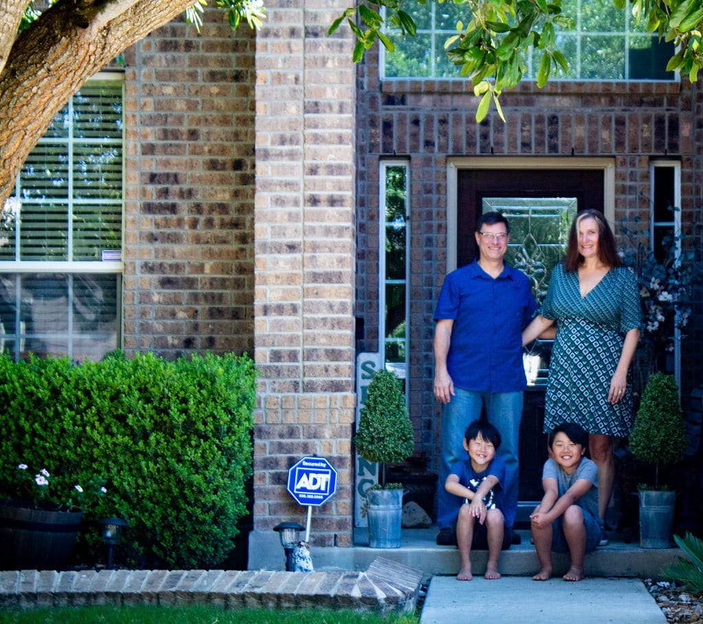 family picture outside of home
