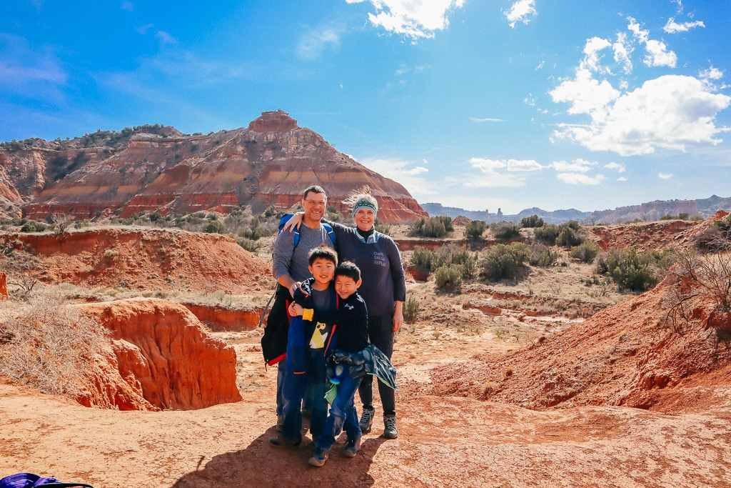 family picture in mountains traveling