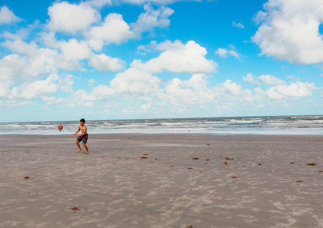 Boy playing ball on beach