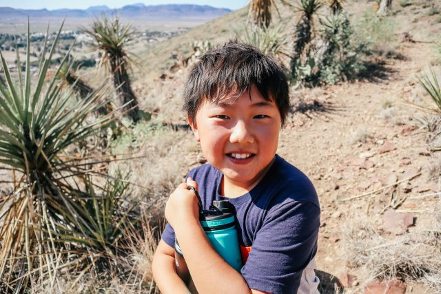 Boy with water bottle in West Texas