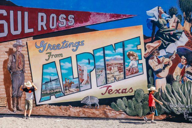 Two boys by Alpine mural in Alpine TX