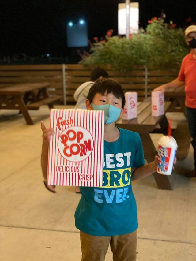 Boy with snack at Stars and Stripes Drive in
