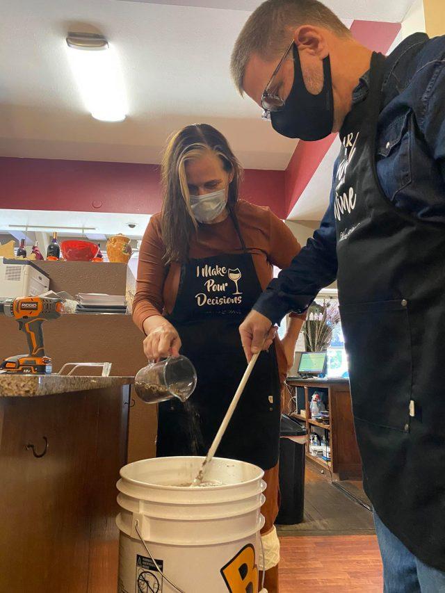 Couple making wine